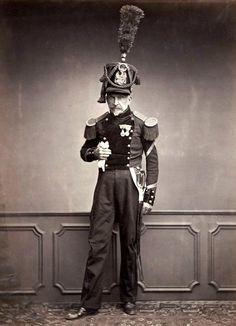 Monsieur Lefebre, a sergeant in the 2nd Regiment of Engineers in 1815, standing wearing a plumed shako.