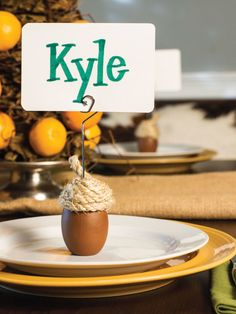 Thanksgiving Centerpiece Ideas: Acorn Place Card Holder >> http://www.hgtvgardens.com/thanksgiving/acorn-place-card-holders?soc=pinterest