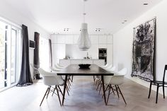 Danish home / Kitchen and dining table made by Københavns Møbelsnedkeri, Eames chairs, Flos lamps