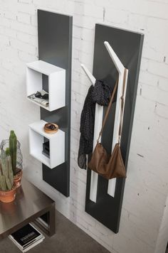 Integrating a host of configurations into its elegant design, this wall panel system offers an intuitive option in paneling, shelving and storage design. Hallway Furniture, Cheap Furniture, Furniture Online, Garderobe Modern Design, Room Interior, Interior Design Living Room, Entryway Cabinet, Wall Design, House Design