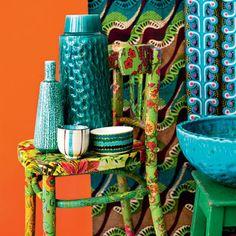 Blue crockery on patterned chair