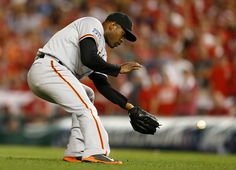 San Francisco Giants' Santiago Casilla (46) scoops up a ball against the Washington Nationals in the ninth inning at Nationals Park for their NLDS game in Washington D.C., on Friday, Oct. 3, 2014.  (Nhat V. Meyer/Bay Area News Group)