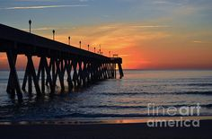 "This beautiful scene of the ""1st Sunrise Of 2015'' was photographed by Bob Sample of PKS Images at Mercers Pier on Wrightsville Beach NC as the sun was making it's first appearance of the new year."