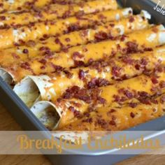 Breakfast Enchiladas  1 lb sausage 2 cups shredded cheddar cheese 8 (8 in) flour tortillas 6 eggs 1 T all-purpose flour 2 cups of half and half 3 oz of real bacon bits