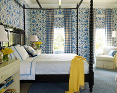Traditional Style bedroom with cornflower Blue and White wallpaper with complimentary color Lemon Yellow decorative accessories