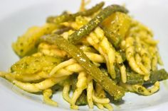 Pour green beans to the boiled salted water in a large pot. Cook for 15 minutes and drain. Peel and cut potatoes into small pieces and put them in the same
