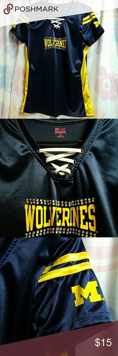 Michigan Wolverines Shirt! Football season is coming soon! Make sure you are prepared to cheer on your favorite team while wearing this Michigan Wolverines Shirt! Made of jersey like material. Never worn. Decorative rhinestones. NWOT Knights Apparel Tops Blouses