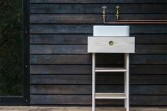 Out of the Valley's first furniture collection, which includes cabin-inspired sinks with surface-mounted copper pipes and vintage taps. Exterior cladding - Shou Sugi Ban sorched timber