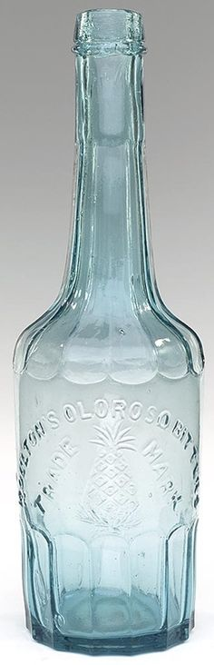 """MOULTON'S OLOROSO BITTERS / TRADE MARK"" / (motif of PINEAPPLE), America, 1870 - 1880. Deep aquamarine, cylindrical with paneled base and fluted shoulders, applied sloping collar with ring - smooth base, ht. 11 ¼""."