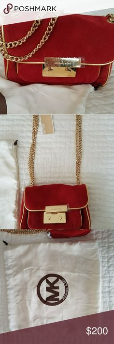 """🎉HP🎉 Michael Kors Small Specchio Sloan Suede Bag NWT and original dust bag!    ?Red suede with gold trim. ?Golden hardware ?Link-chain shoulder strap ?Front flap with Michael Kors logo-engraved snap closure. ?Front exterior open pocket. ?Inside, contrast MK monogram lining, one open pocket, center zip compartment, one zip pocket and six card slots. ?5 1/2""""H x 8 1/2""""W x 2 1/2""""D.Imported.  There are two small discolorations; 1 just under the front snap closure, the other is on the bottom of…"""