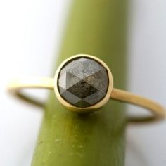 thin yellow gold setting like this, but with a white diamond. Diamond Bezel setting engagement ring