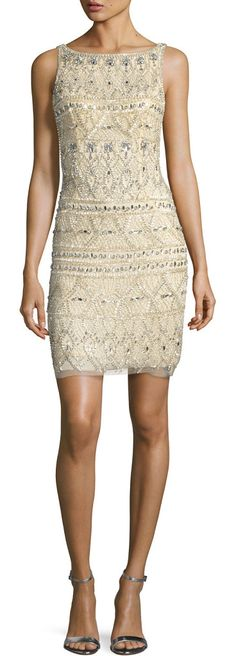 Sleeveless beaded cocktail dress by Jovani. Jovani cocktail dress with patterned beading. Bateau neckline; low-cut V'd back. Sleeveless; thin straps. Sheath silh...