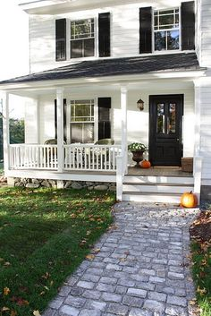 White With Black Front Door And Shutters Stone Foundation