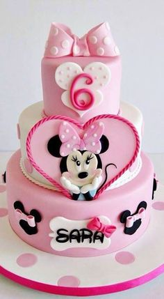 If you're planning a Minnie Mouse birthday party, check out the 10 Cutest Minnie Mouse Cakes. These Minnie Mouse cake designs will blow you away with their creativity. Find Minnie Mouse cakes with pink, red and even purple designs. Minnie Mouse Cake Design, Minni Mouse Cake, Bolo Do Mickey Mouse, Mickey And Minnie Cake, Bolo Minnie, Minnie Mouse Birthday Cakes, Mickey Cakes, Birthday Cake Girls, Mickey Birthday