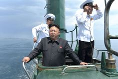 North Korean leader Kim Jong Un (front) in the conning tower of a submarine during his inspection of the Korean People's Army (KPA) Naval Unit 167 in this undated photo released by North Korea's Korean Central News Agency (KCNA) in Pyongyang on June 16, 2014. (Reuters/KCNA)