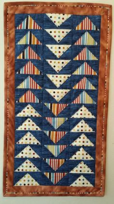 5 minute block Table runner. ( Block designed by Suzanne McNeill).   This has a binding called Susies Magic Binding.