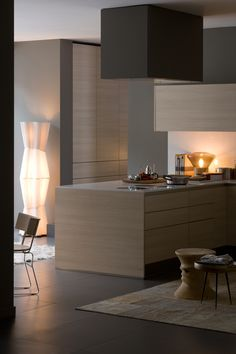Arclinea Kitchen.   Over the burners, the Signum hood.