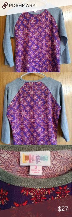 LuLaRoe Randy Size small LuLaRoe Randy.  If you look close, there is a bit of pilling but otherwise it's in great shape....just too big on me.  😕 LuLaRoe Tops Tees - Short Sleeve