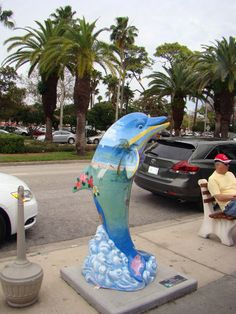Dolphin statues line the streets as part of Sea Venice Arts Project. A small version would look awesome!!!