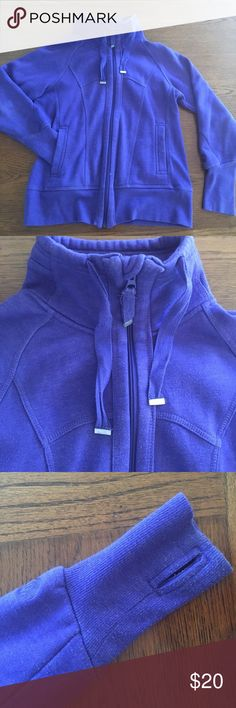 Purple running jacket Barely worn purple jacket. The sleeves have thumb holes and the material is thick and very warm for morning runs. The tag says medium but it has a snug fit. Tops Sweatshirts & Hoodies