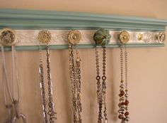 This wall hung rack with its attractive finish and embossed background will add beauty and function to your storage and organizational needs So Many possible uses. Towel / robe holder , Scarves,Jewelry, necklaces. purse and coat rack are just a few. Perfect handmade gift.One size fits all .Choices designed to match your decor and style. Special orders available on color combinations, overall length and number of knobs. Just convo me with your specific needs or ideas base is architect...