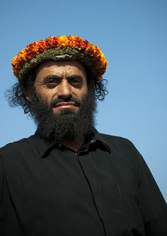 Hadi, Flower Man from Al Farsha - Saudi Arabia | by Eric Lafforgue - The flower men live in Yemen and Saudi Arabia. They wear a headdress made with fresh flowers and smelly grasses.