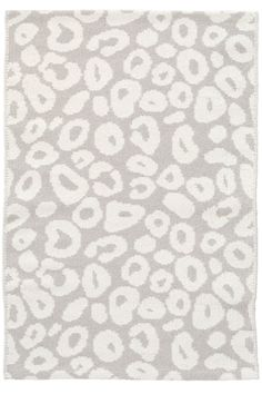 Dash and Albert Spot Pearl Grey Woven Cotton Rug. An ivory animal print on a soft grey backdrop makes this woven cotton rug a subtly a versatile, personality-packed addition to any room.