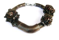 Terhi Tolvanen ~Florex 2011. Necklace Ø 22cm. Wood (pear, willow), silver, paint. Private collection.