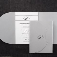 Distinct Silver - Invitation from Carlson Craft - Item Number: BSN9955 - Your monogram is printed between two silver stripes on this white card and slides into a silver wrap. #CarlsonCraft #wedding #pocket