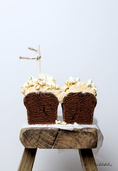 mini chocolate cake with peanut butter frosting and popcorn top