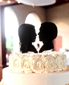 Custom Silhouette Wedding Cake Topper. no.   look at that frosting.