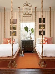 Beds hanging from the ceiling! What an awesome idea and design. For more information about the room, and for more cool bedroom designs, visit: http://www.lushome.com/25-hanging-bed-designs-floating-creative-bedrooms/108047