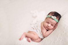 Newborn Fine Art Photos | Newborn Photographer | Meghan Vail Photography | Orlando Quality Newborn Photographer | Peaceful Baby Girl in Cream and Teal