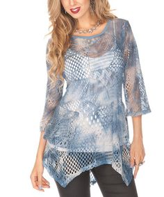 A delightful pattern and sidetail hem give this tunic tons of personality. Slip into this stylish, sheer piece and revel in fashion's glory.