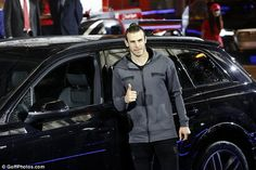 Real Madrid's Gareth Bale is all smiles standing by the door of the popular Audi Q7