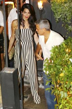 Amal Clooney steps out in sexy stripes for date night with George.