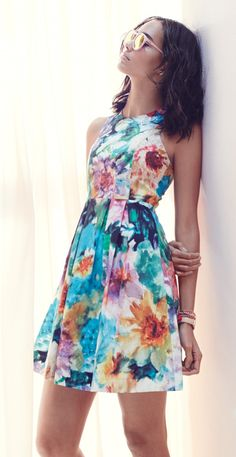 Love the vibrant floral print on this charming fit-and-flare dress!