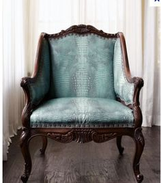 What makes this old chair fresh: modern color of turquoise & use of crocodile fabric