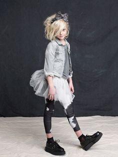 Katrina Tang Photography for Earnshaws magazine Wild Things 2013 kids fashion. Studio shoot with a girl in black boots and skirt #katrinatang #tangkatrina