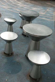 Stainless steel seats that double as drums, rather like a djembe or a dumbek.  These are extremely cool - notice how they are suspended on mini-legs so that the drum is open at the bottom; that's important for good sound.  I imagine they sound great!  No idea at all who makes them or where they are.  Originally Pinned by Alec Duncan of http://childsplaymusic.com.au/