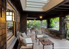 Craftsman porch. Huge!  Love the skylights to keep it bright.