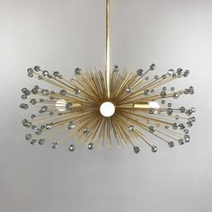 The crystal beaded urchin chandelier is an opulent statement piece perfect for foyers, powder rooms, nurseries, and more. Available in two finishes with a variety of colors of translucent faceted crystal acrylic beads, there's sure to be a combination that will stun in your space. Lead Time: 1 Week Measurements: - Diameter: 27 in (or 31 in) - Fixture Height: 12 in (or 13 in) - Overall Height: 14 in (or 15 in) - Weight: 8 lbs (or 9 lbs) Features: - Brass or nickel plated finishes - Hundreds… Faceted Crystal, Crystal Beads, Crystals, Mid Century Modern Chandelier, Modern Led Ceiling Lights, Loft Style, Acrylic Beads, Chandelier Lighting, Interior Styling