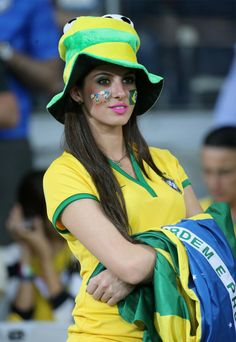 Talk about losing gracefully! This Brazilian beauty makes losing look very appealing as she watched her team lose 7-1 against Germany during the semi-final match on July 8, 2014.