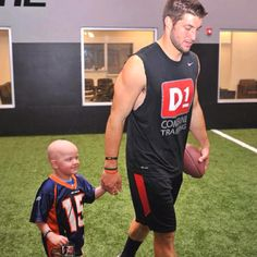While most QB's are getting prepared for the next season, Tim Tebow is spending his time with cancer patients. If thats not a hero, then I don't know what is.