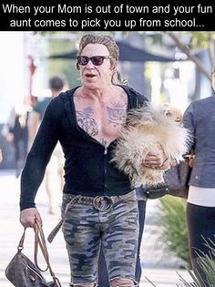 NOBODY can make fun of Mickey Rourke, his pup, and his Luis Vuitton bag. NOBODY!!! ❤❤❤