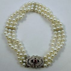 3-Strand Pearl Bracelet with Diamond and Ruby Clasp in White Gold. $1,600
