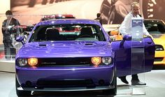 L.A. and Tokyo Motor Show: A man steps out of a 2014 Challenger SRT from Dodge