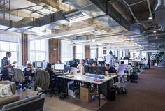The main workspace itself is fairly standard for today's tech companies, marked by benching systems along the window line (a more progressive office design) ...