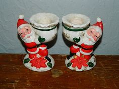 Hey, I found this really awesome Etsy listing at https://www.etsy.com/listing/167092314/vintage-santa-claus-candle-stick-holders