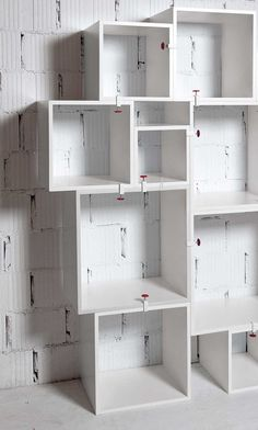 Modular asymmetrically staggered cubes designed by Selab. Great as a bookshelf or to display decor.